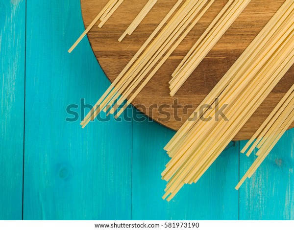 Dried Italian Style Linguini Pasta on a Kitchen Chopping Board