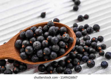 dried juniper berries on a white background