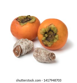 Dried kaki fruit and fresh orange ones isolated on white background