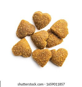Dried kibble pet food. Heart shape dried animal food isolated on white background.