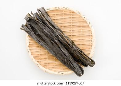 Dried kombu seaweed Japanese dry kelp on a bamboo sieve
