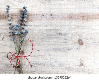 Dried lavander bouquet on a wooden surface with copy space