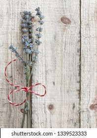 Dried lavander bouquet on wooden surface with copy space