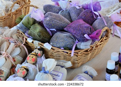 Dried lavender filled sacks, lavender essential oil, lavender products at the farmers market.