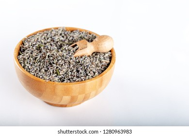 Dried lavender flowers in wooden bowl on white background
