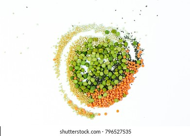Dried legumes and seeds, top view. Red lentils, peas, couscous, chia seeds.