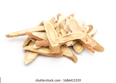 dried liquorice roots on white background