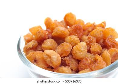 dried longan fruit on white background