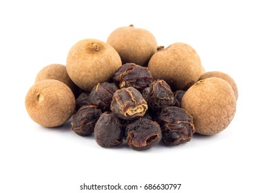 Dried longan whole fruit on white background.