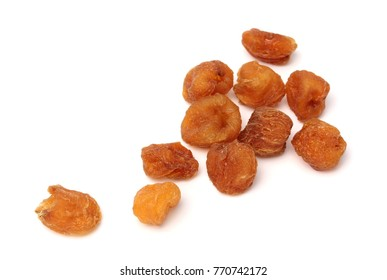 Dried longan whole meat on white background.