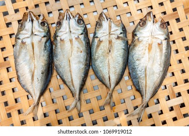 Dried Mackerel fish on bamboo basket, Asian traditional salted fish drying on the sun for consumption.