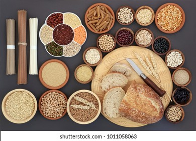 Dried macrobiotic diet health food with sourdough bread, soba and udon noodles, legumes, seaweed, grain, cereal, seeds and whole wheat pasta. High in smart carbs, protein, fibre and antioxidants.