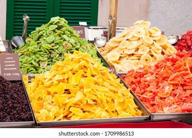 Dried mango, kiwi, dates, banana), pineapple, cranberry  for sale on Porreres Market. Majorca, Spain