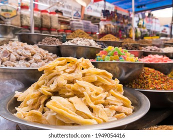 dried mango in stainless bowl with many kind of dried fruits, sweets and spices in stall at Manek Chowk, Ahmedabad, India.