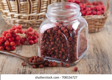 Dried mountain ash in a glass jar