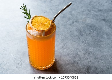 Dried Orange Cocktail with Foam, Rosemary and Metal Straw.