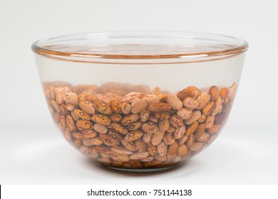 Dried orange coloured beans absorb water