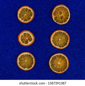 Dried orange slices. Background made in trendy classic blue color of the year 2020. Top view, flat lay