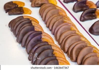 Dried orange slices cover with dark and milk chocolate