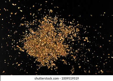 dried Oregano on black background