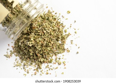 Dried Oregano Spilled from a Spice Jar