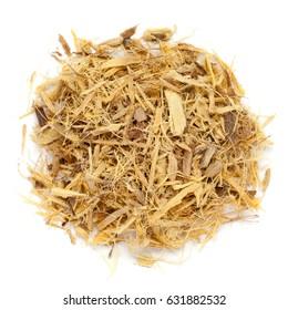 Dried Organic Liquorice roots (Glycyrrhiza glabra) isolated on white background. Macro closeup. Top view.