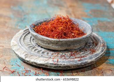 Dried organic red saffron Spice on wooden background