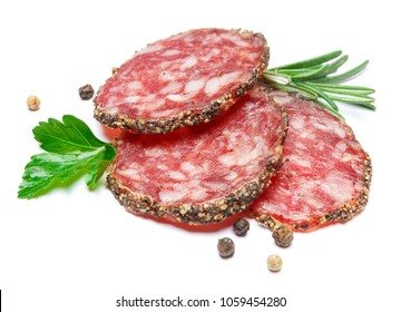 Dried organic salami sausage covered with pepper on white background