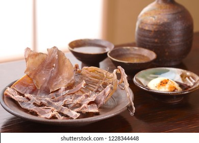 Dried Pacific flying squid on wooden table