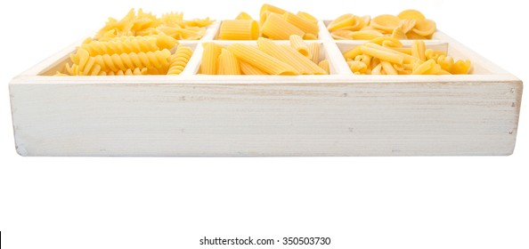Dried pasta assortment of different shape in a white box over white background