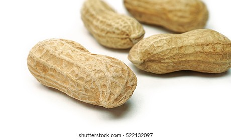 Dried peanuts, Monkey nuts, Groundnuts in shell, Isolated on white background close up