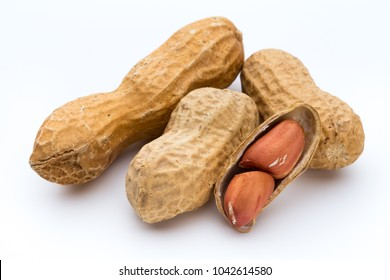 Dried peanuts on the white background.
