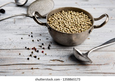 Dried Peas in Cooking Pot with Kitche  Utensils and Pepper