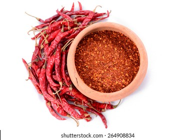 dried peppers and red chilli powder on white background