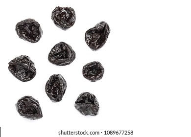 Dried plum - prunes isolated on a white background with copy space for your text. Top view. Flat lay