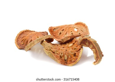 dried quince slices on a white background