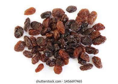 Dried raisins on white background