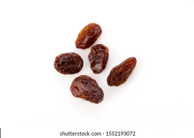 Dried raisins on white background.