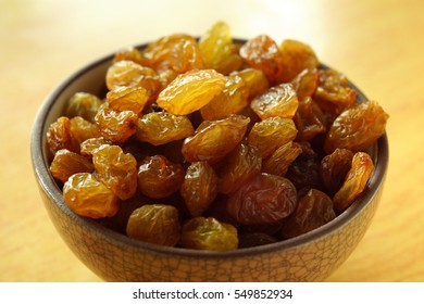 Dried raisins in a small vase