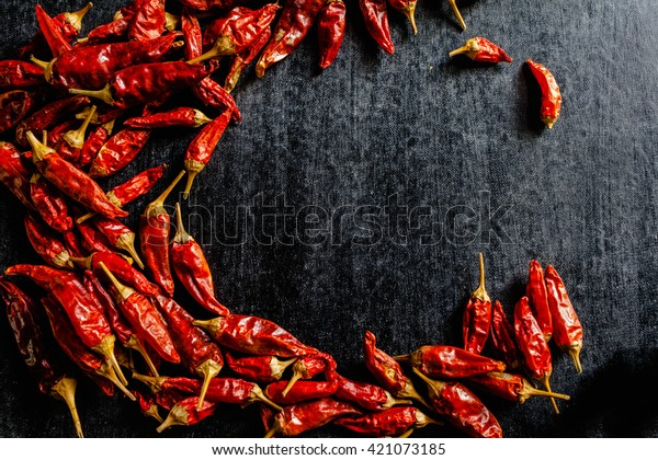 dried red chili pepper spice , closeup.