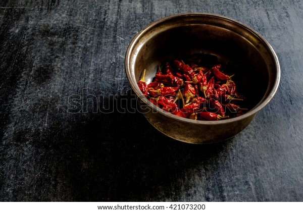 dried red chili pepper spice , closeup.