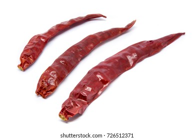 Dried red chili peppers isolated on white background