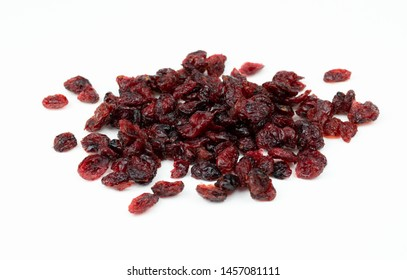 Dried red cranberries isolated on a white background.