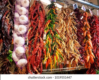 Dried red and green peppers hanging in Barcelona Market (Mercat de Sant Josep de la Boqueria) on the La Rambla street, Barcelona, Spain