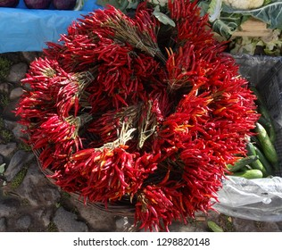 Dried red hot chili  peppers on a farmers market stall in the Aegean coastal town Ayvalik, Turkey.