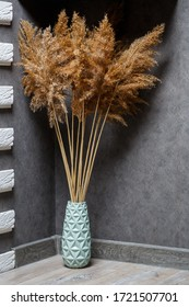 Dried reeds as home decor. Minimalistic cozy interior. Natural interior. Still life with a reed. Grass for interior design