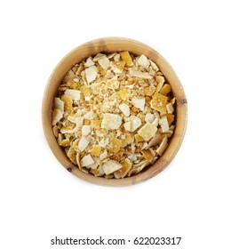 dried rind of lemon in wooden cup isolated