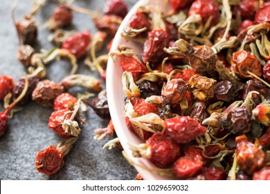 Dried ripe rose hip fruit. Antioxidant, source of vitamin C, immunity protection used during cold winter time with herbal tea. Organic farm product. Raw vegan vegetarian healthy food concept.