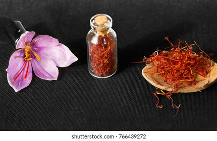 Dried saffron spice  in a bottle, Saffron flower and spoon with saffron types