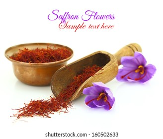 Dried saffron spice and Saffron flower isolated on white